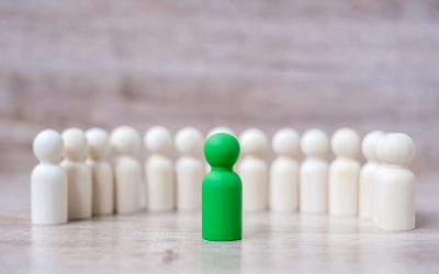 Green leader businessman with crowd of wooden men. leadership, b