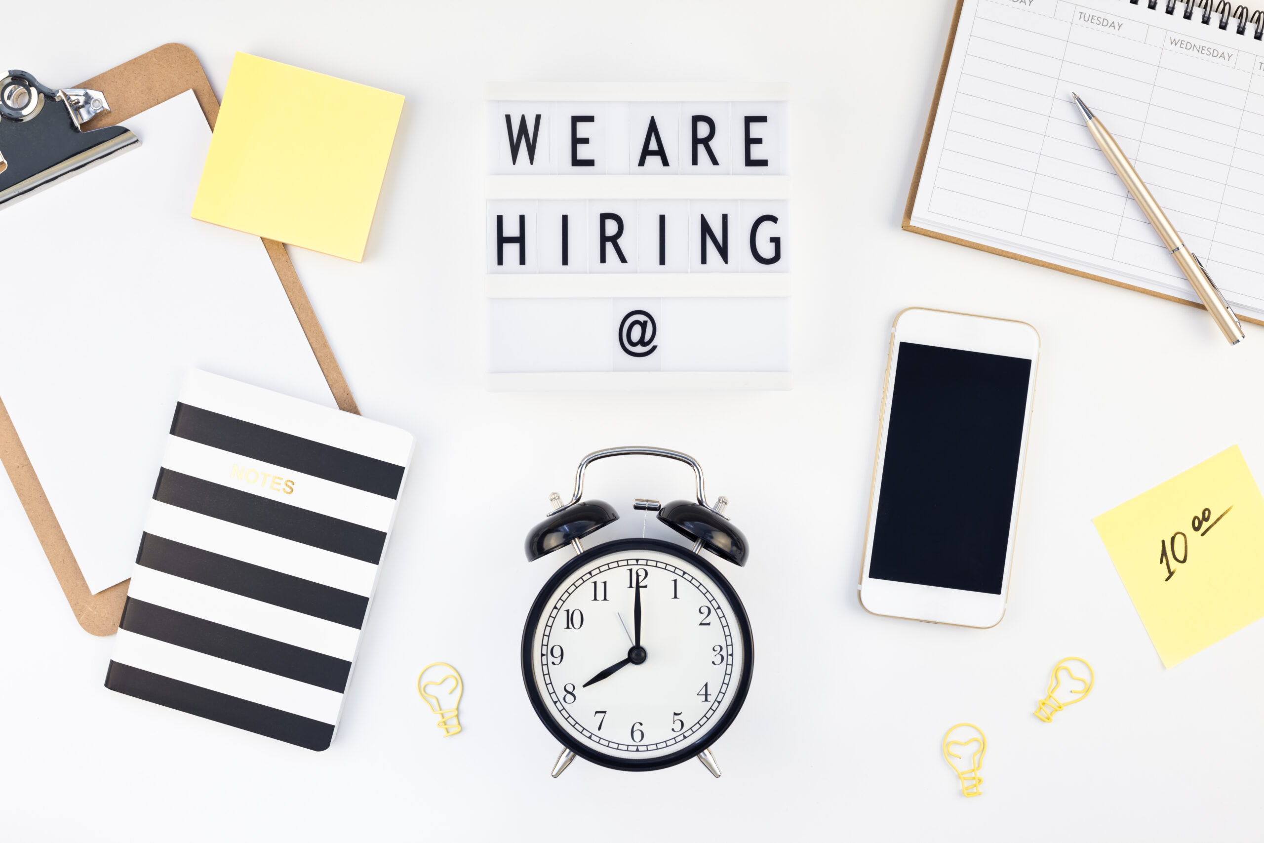 We are hiring flat lay on white background